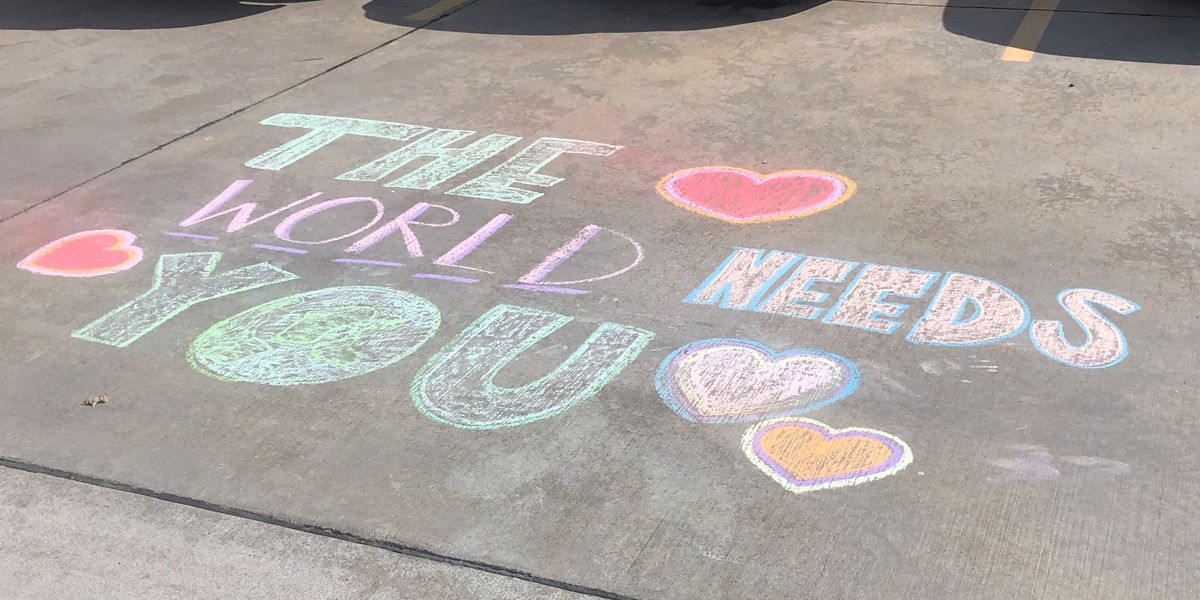 Sidewalk chalk messages of support for Heartland healthcare workers