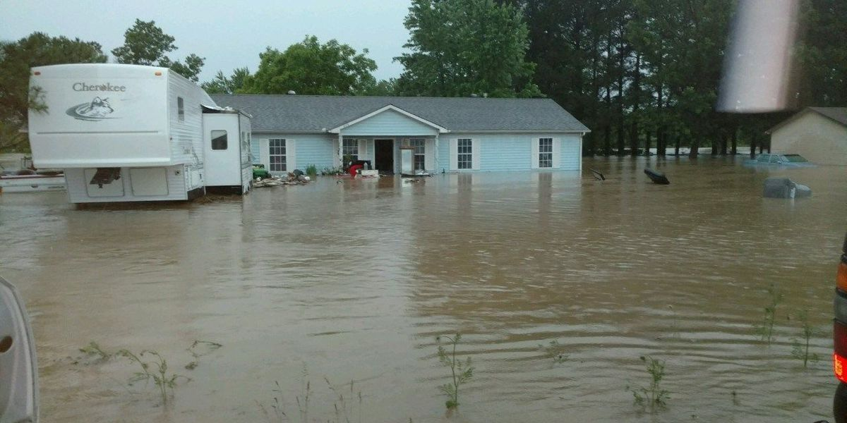 Family tired of home getting destroyed by flood waters