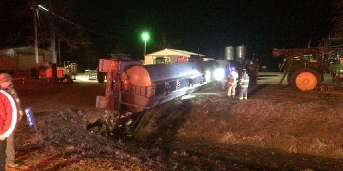 Tractor trailer flips over in Bono