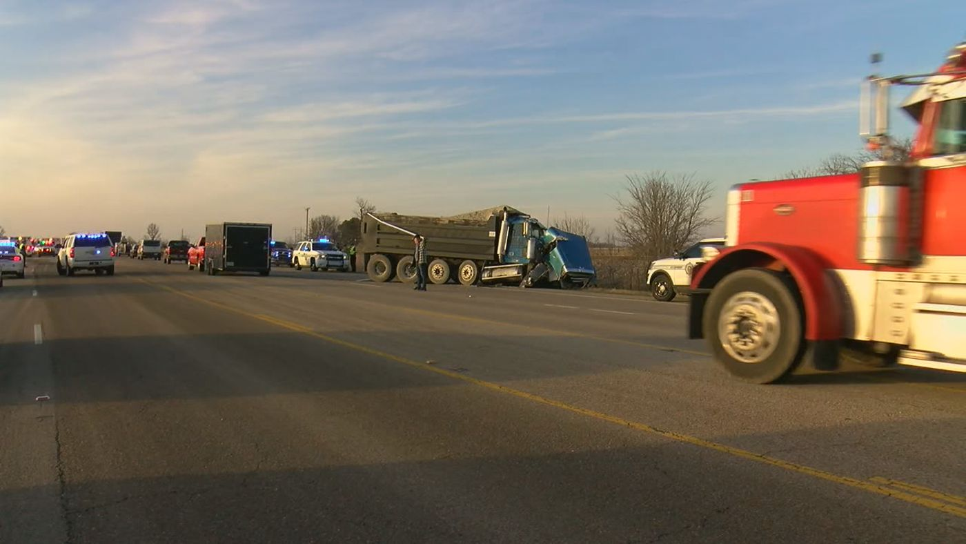 The crash involves a Hoxie school bus, a dump truck, several other vehicles and injuries are reported.