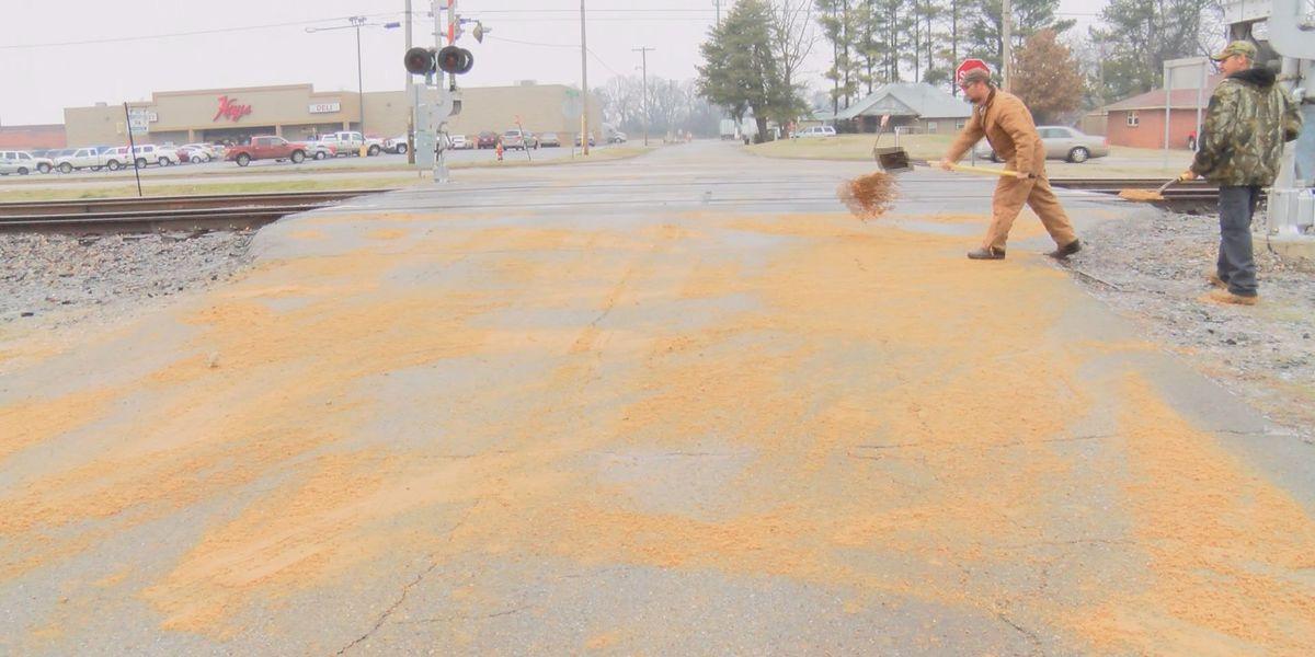 Walnut Ridge Street Dept. spreads sand mixture by hand
