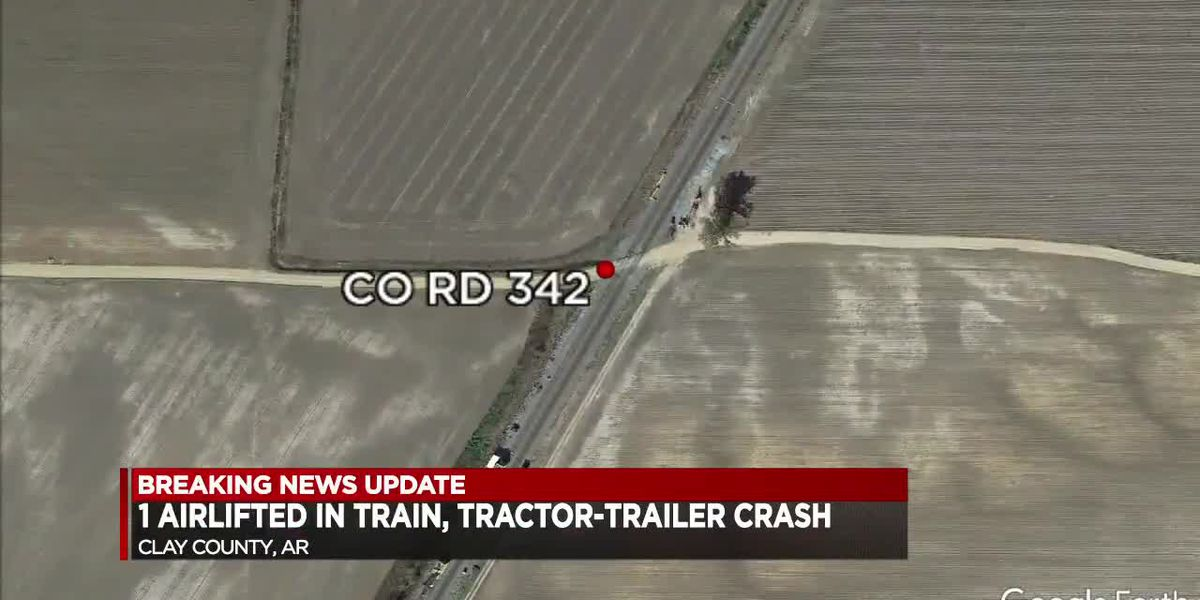 1 airlifted after train crashes into tractor trailer