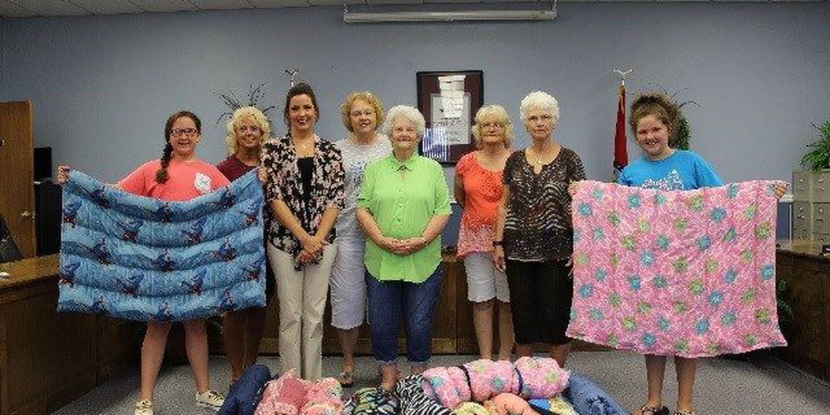 Volunteers donate therapeutic blankets to school district