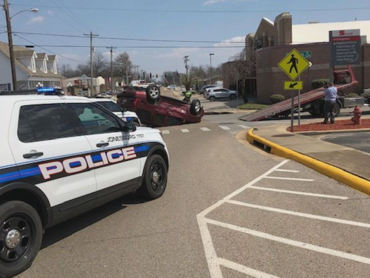 Car flips in downtown intersection