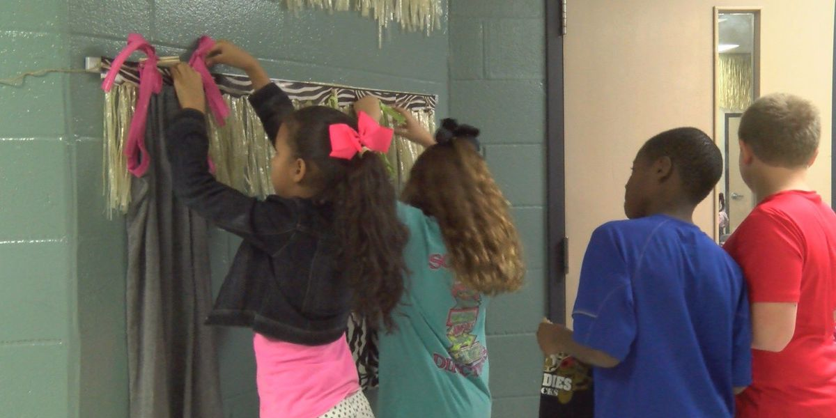 Fourth grade students learn to sew to help others