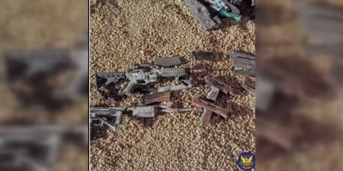 Homeowners dig up duffel bag full of guns in backyard