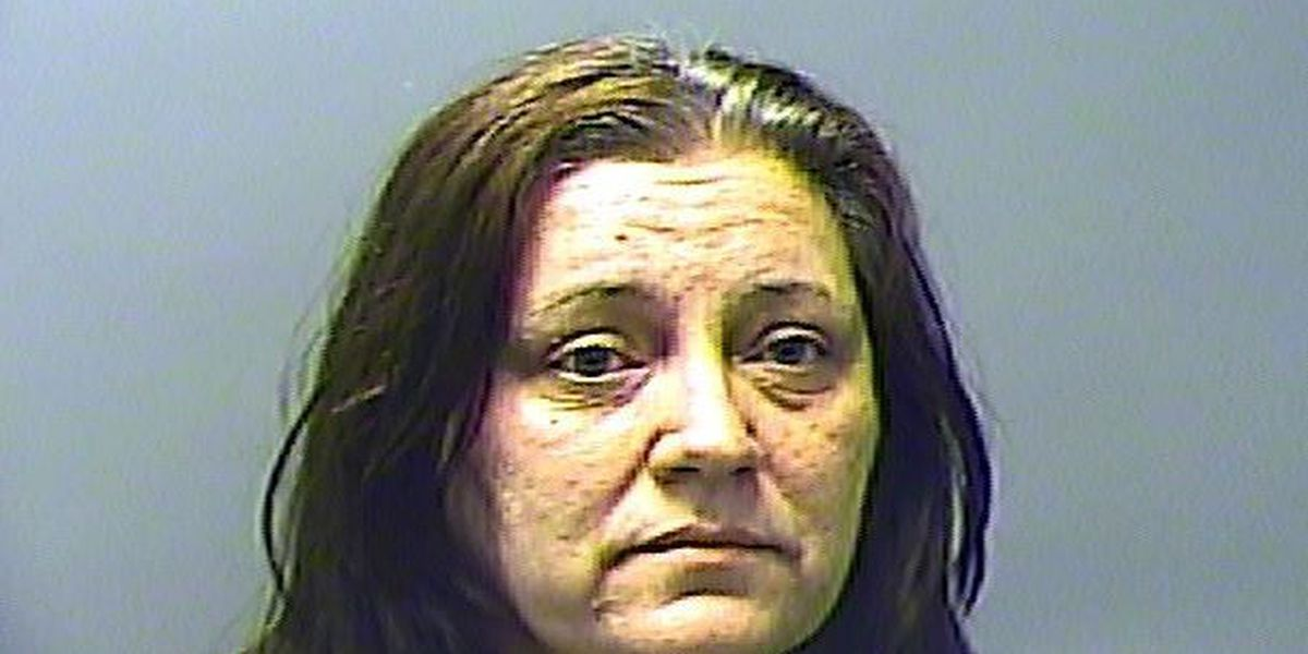 Woman facing forgery charge after family finds counterfeit cash