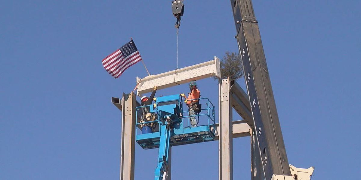 Crews raise final beam for new Blessed Sacrament church