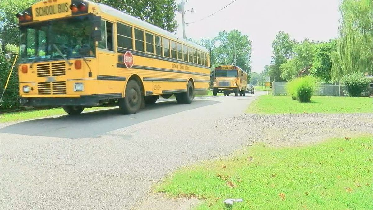 Narrow road has neighbors near school asking questions