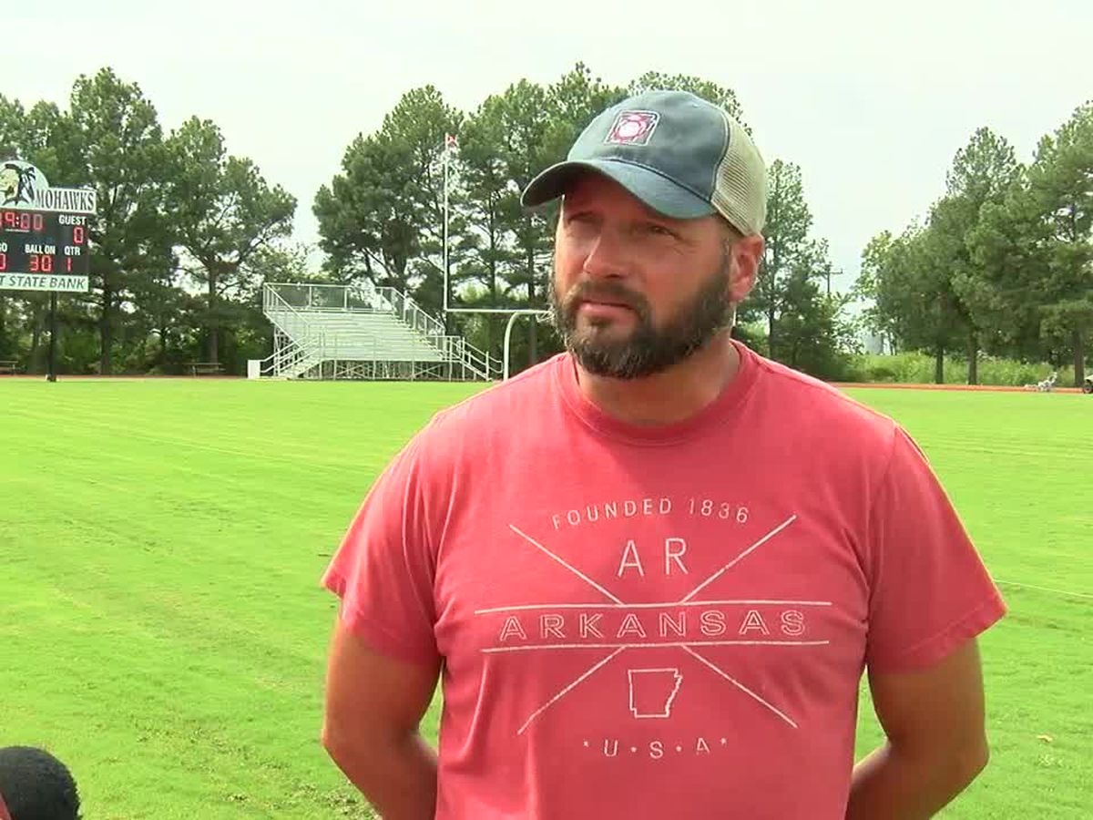 Piggott football coach 'reassigned'