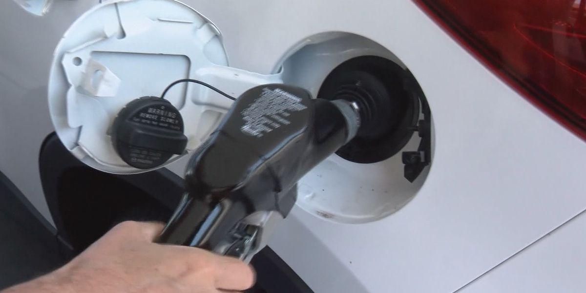 Gas prices tick upward as demand plummets