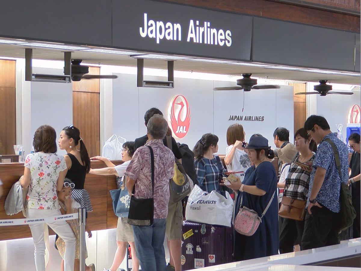 Japan looks for missing after typhoon, warns of mudslides