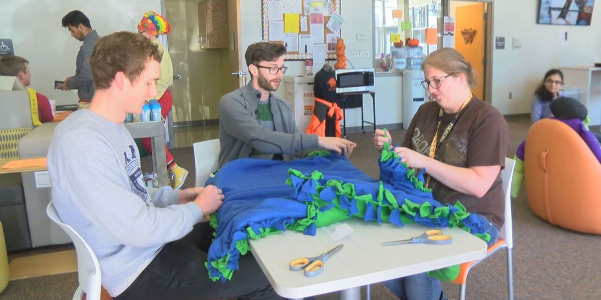 Students crafting, distributing fleece blankets to homeless